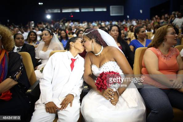 Joyce and Gabrieli kiss before marrying at what was billed as the world's largest communal gay wedding on December 8 2013 in Rio de Janeiro Brazil...