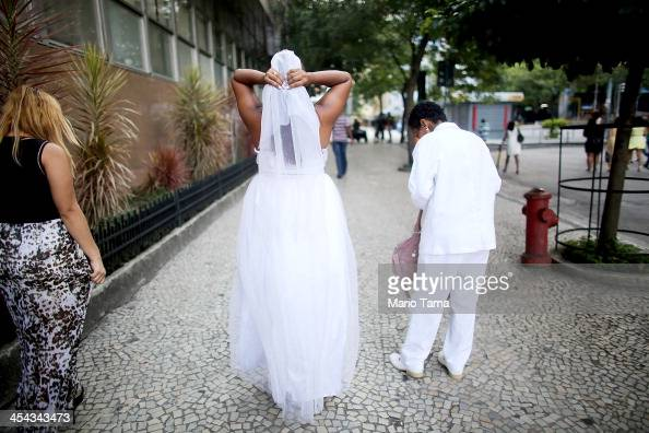 Joyce and Gabrieli walk out after marrying at what was billed as the world's largest communal gay wedding on December 8 2013 in Rio de Janeiro Brazil...
