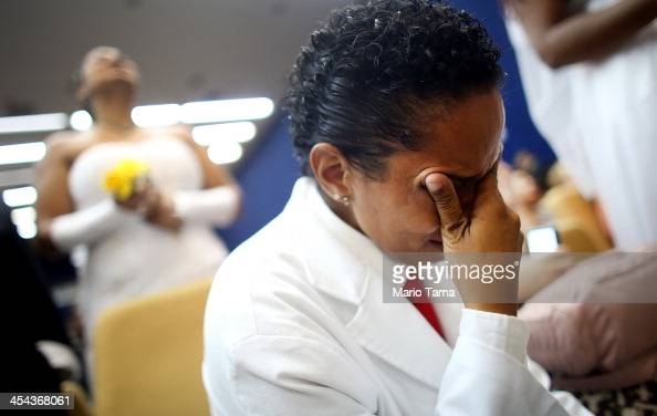 Joyce cries after marrying at what was billed as the world's largest communal gay wedding on December 8 2013 in Rio de Janeiro Brazil 130 couples...