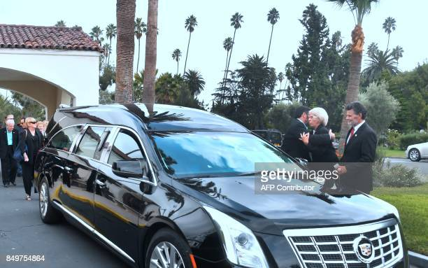 Joyce Flint receives condolences beside the vehicle carrying the coffin of her husband Mitchell Flint on September 19 2017 at the Hollywood Forever...