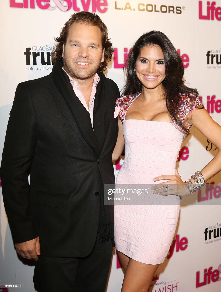 <a gi-track='captionPersonalityLinkClicked' href=/galleries/search?phrase=Joyce+Giraud&family=editorial&specificpeople=841715 ng-click='$event.stopPropagation()'>Joyce Giraud</a> (R) and husband, <a gi-track='captionPersonalityLinkClicked' href=/galleries/search?phrase=Michael+Ohoven&family=editorial&specificpeople=722195 ng-click='$event.stopPropagation()'>Michael Ohoven</a> arrive at Life & Style presents 'Hollywood In Bright Pink' held at Bagatelle on October 9, 2013 in Los Angeles, California.