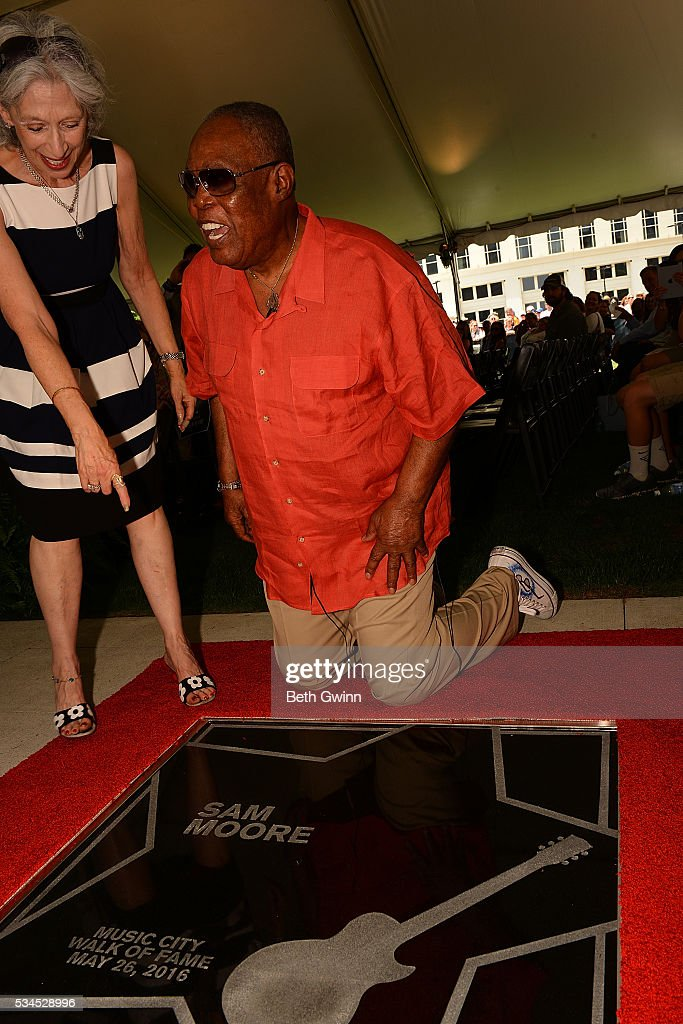 Joyce Moore and <a gi-track='captionPersonalityLinkClicked' href=/galleries/search?phrase=Sam+Moore&family=editorial&specificpeople=828179 ng-click='$event.stopPropagation()'>Sam Moore</a> with his star at the Walk of Fame Park on May 26, 2016 in Nashville, Tennessee.
