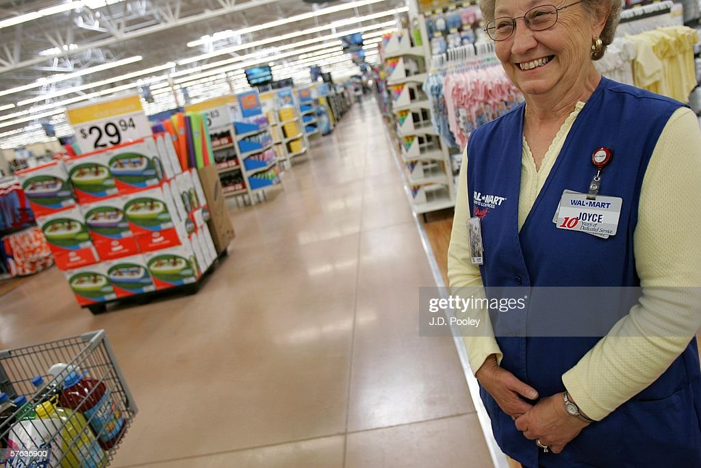 Joyce Smith, who has been working at Wal-Mart for the past 13 years, smiles at a customer during the grand opening of a new 2,000 square foot Wal-Mart Supercenter store May 17, 2006 in Bowling Green, Ohio. The new store, one of three new supercenters opening today in Ohio, employs 340 people with 60 percent of those working full-time.
