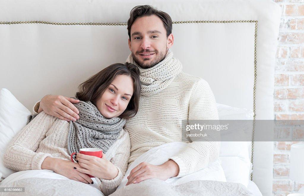 Joyful bearded man hugging his girlfriend : Stock Photo