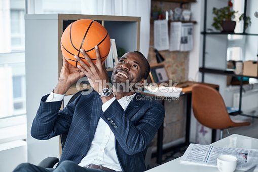 Joyful businessman is keeping ball in hands : Stock Photo
