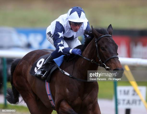 Joyful Friend ridden by William Buick wins the 32Red Maiden Stakes at Lingfield Park Racecourse Surrey