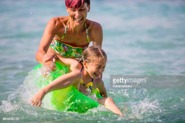 Joyful Little Girl Play With Her Mother In The Sea Water - Close Up