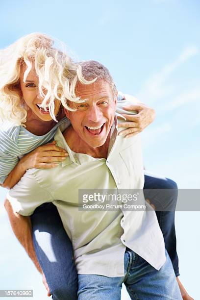 Joyful mature woman enjoying a piggyback ride