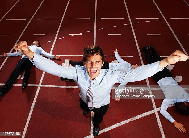 Joyful middle aged executive winning a business race