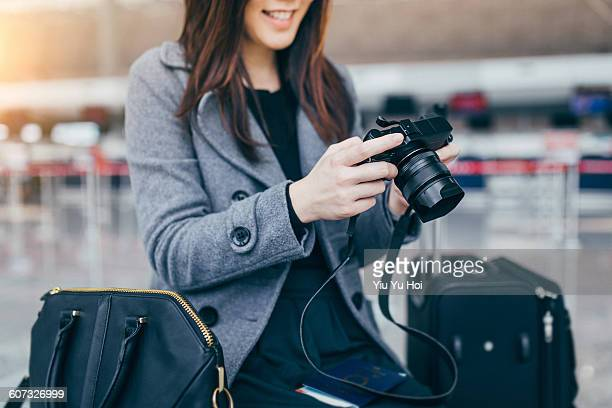Joyful woman enjoying the photos taken by camera