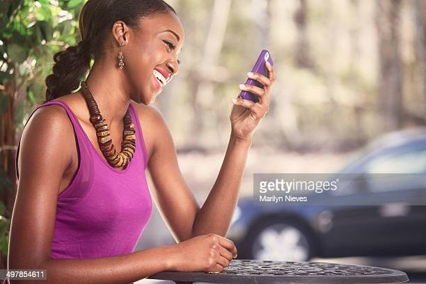 joyful woman texting