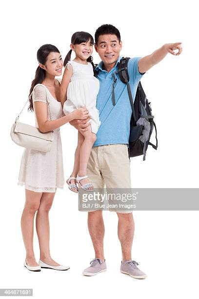 Joyful young family looking at view