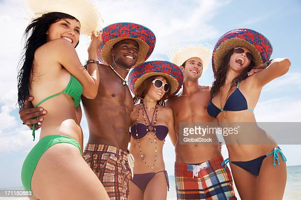 Joyful young friends enjoying their vacation on beach
