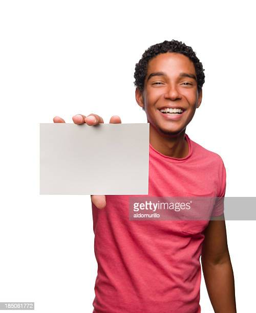 Joyful young man holding a blank business card