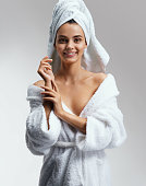 Joyous attractive girl in white bathrobe after spa. Wellness and Spa concept