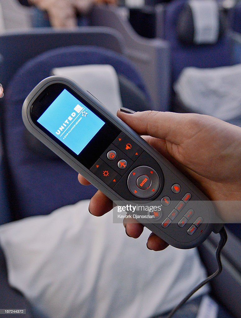 A joystick for the personal entertainment systems is shown on the United Airlines Boeing 787 Dreamliner at Los Angeles International Airport on November 30, 2012 in Los Angeles, California. In January the new jet is scheduled to begin flying daily non-stop between Los Angeles International airport and Japan's Narita International Airport and later to Shanghai staring in March. The new Boeing 787 Dreamliner will accommodate 219 travelers with 36 seat in United Business First, 70 seats in Economy Plus and 113 in Economy Class. The carbon-fiber composite material that makes up more than 50 percent of the 787 makes the plane jet and more fuel-efficient.