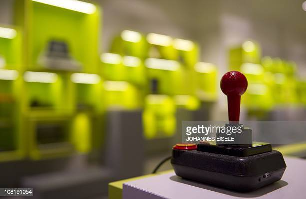 A joystick is displayed at the new Computer Game Museum in Berlin on January 20 opening for the public on January 21 2011 Spread over 670 square...