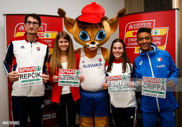 Jozef Repcik of Slovakia Konstanze Klosterhalfen of Germany official mascot Lucia Janeckova of Slovakia and Yemaneberhan Crippa attend a press...