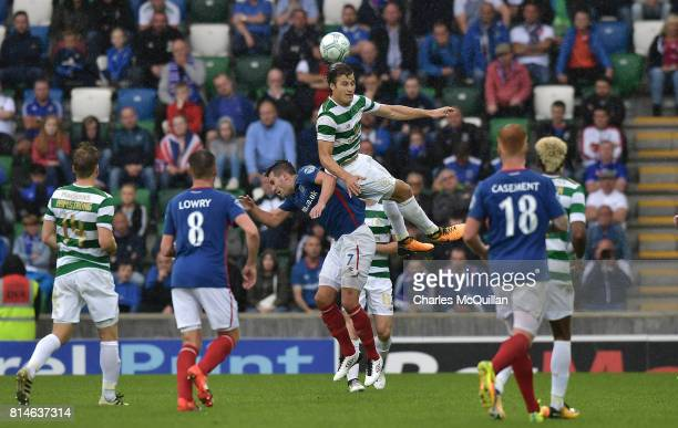 Jozo Simunovic of Celtic and Andrew Waterworth of Linfield during the Champions League second round first leg qualifying game between Linfield and...