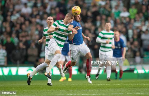 Jozo Simunovis of Celtic goes up with Andrew Waterworth of Linfield during the UEFA Champions League Qualifying Second RoundSecond Leg match between...