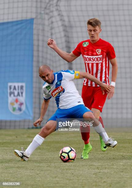 Jozsef Kanta of MTK Budapest covers the ball from Gabor Makrai of DVTK during the Hungarian OTP Bank Liga match between MTK Budapest and DVTK at...