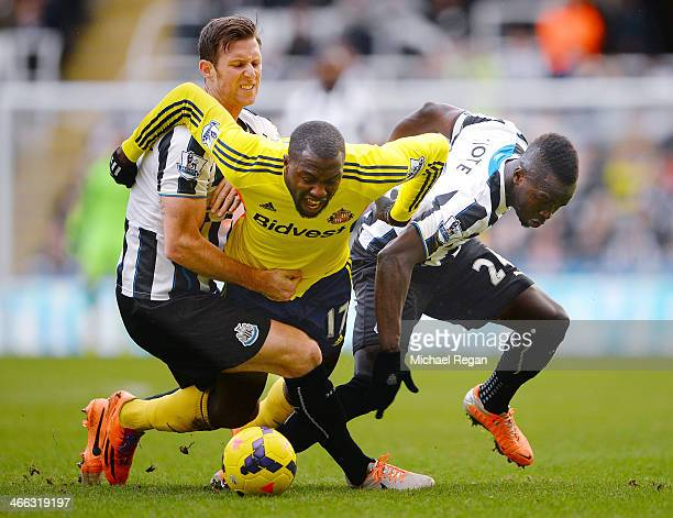 Jozy Altidore of Sunderland is brought down by Michael Williamson and Cheik Ismael Tiote of Newcastle during the Barclays Premier League match...
