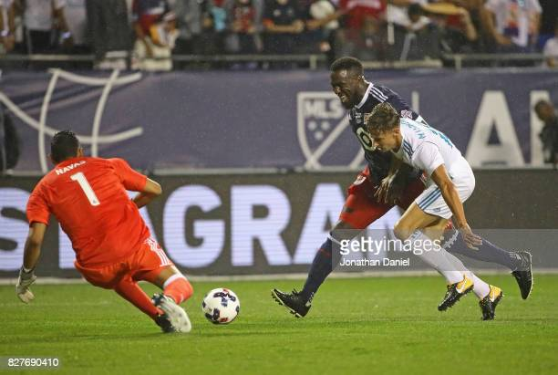 Jozy Altidore of the MLA AllStars gets off a shot under pressure from Marcos Liorente of Real Madrid as Keylor Navas moves in for the save during the...