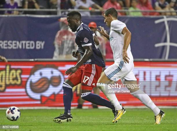 Jozy Altidore of the MLS AllStars is pressured by Theo Hernandez of Real Madrid during the 2017 MLS All Star Game at Soldier Field on August 2 2017...