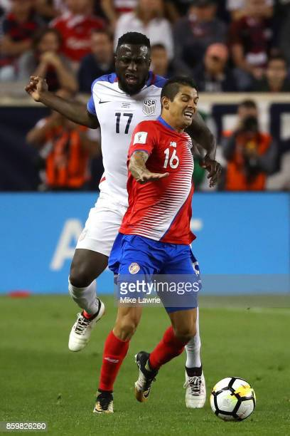 Jozy Altidore of the United States competes for the ball with Cristian Gamboa of Costa Rica during the FIFA 2018 World Cup Qualifier at Red Bull...