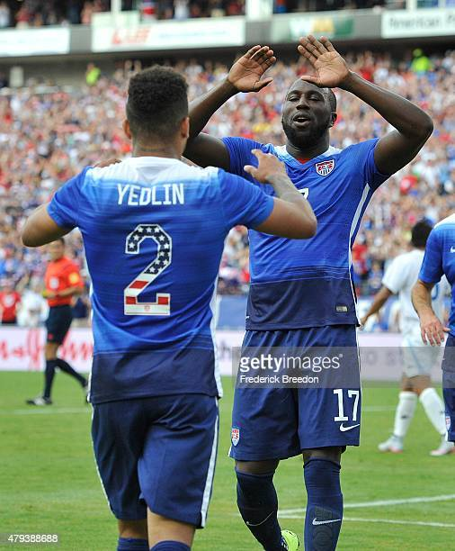 Jozy Altidore of the United States congratulates teammate DeAndre Yedlin after a USA goal during an international friendly soccer match between the...