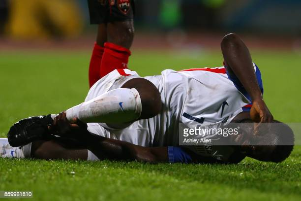 Jozy Altidore of the United States mens national team feels the pain of a rough tackle during the FIFA World Cup Qualifier match between Trinidad and...
