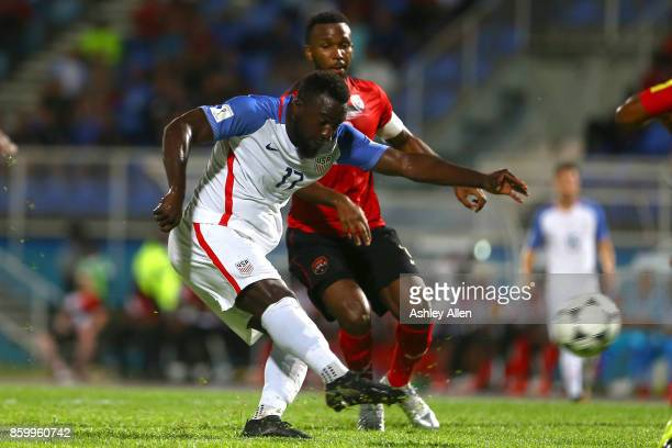 Jozy Altidore of the United States mens national team has a shot at goal as Khaleem Hyland of Trinidad and Tobago attempts to block the shot during...