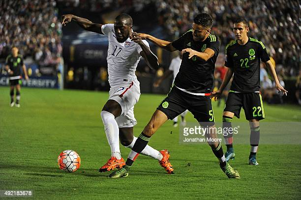 Jozy Altidore of the United States moves the ball past Diego Reyes of Mexico during the 2017 FIFA Confederations Cup Qualifier at Rose Bowl on...