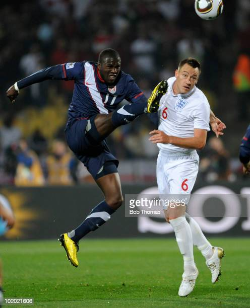 Jozy Altidore of the USA kicks the ball past John Terry of England during the 2010 FIFA World Cup South Africa Group C match between England and USA...