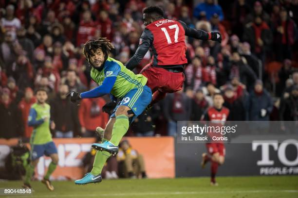 Jozy Altidore of Toronto FC and Roman Torres of Seattle Sounders go up for the ball during the 2017 Audi MLS Championship Cup match between Toronto...
