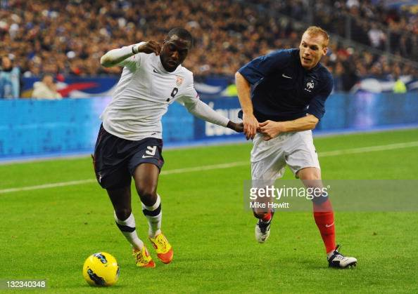 Jozy Altidore of USA is challenged by Jeremy Mathieu of France during the International Friendly between France and USA at Stade de France on...