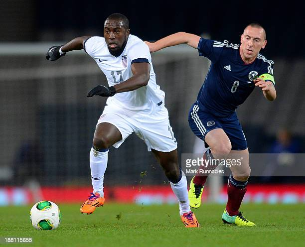 Jozy Altidore of USA takes the ball away from the challenge of Scott Brown of Scotland during the International Friendly match between Scotland and...