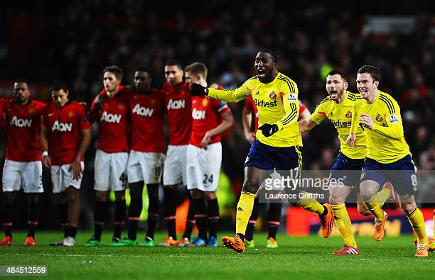 Jozy Altidore Phil Bardsley and Adam Johnson of Sunderland celebrate following their team's 21 victory in the penalty shootout during the Capital One...