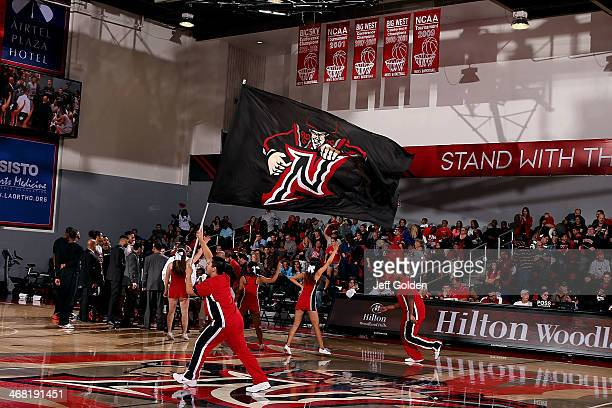 Jp De Jesus of the Cal State Northridge Matadors Cheer Team waves a flag with the university logo during a timeout against the UC Santa Barbara...