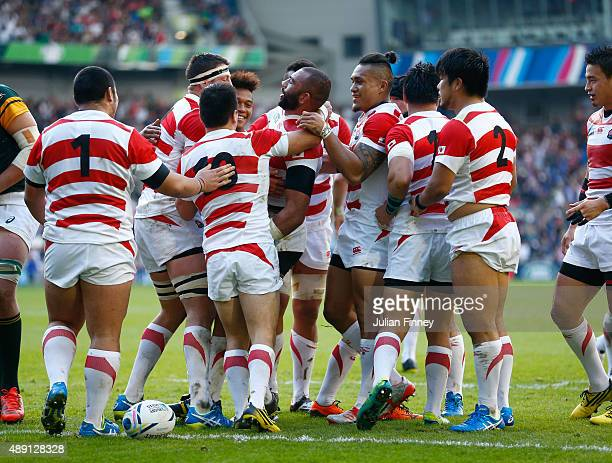 Jpaan players celebrate the try of Michael Leitch of Japan during the 2015 Rugby World Cup Pool B match between South Africa and Japan at the...