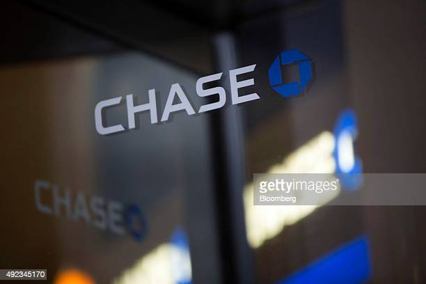 A JPMorgan Chase Co bank logo is seen on a revolving door of a branch in Chicago Illinois US on Monday Oct 5 2015 JPMorgan Chase Co is scheduled to...