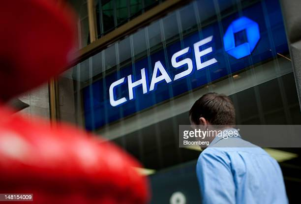 JPMorgan Chase Co signage is displayed at a bank branch in New York US on Friday July 6 2012 JP Morgan Chase Co is scheduled to release earnings data...