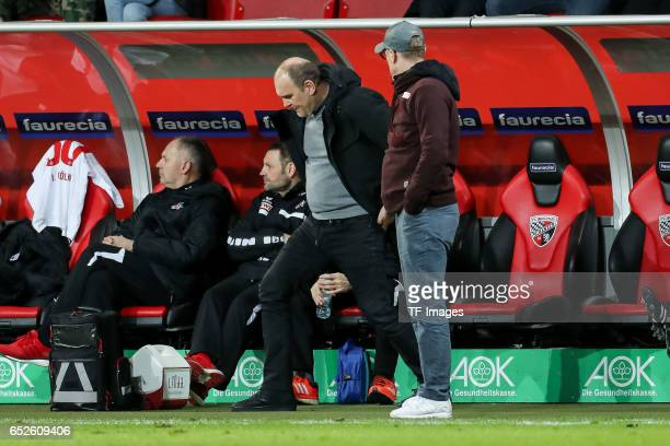 Jörg Schmadtke of Cologne and Head coach Peter Stoeger of Cologne looks on during the Bundesliga match between FC Ingolstadt 04 and 1 FC Koeln at...