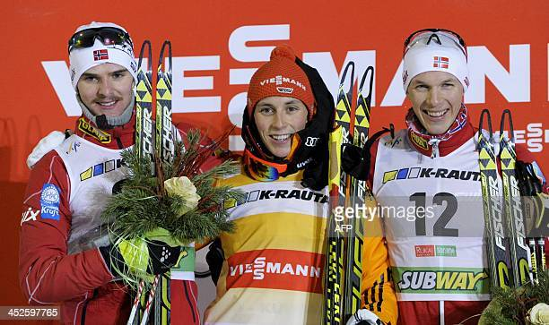 Jörgen Graabak of Norway winner Eric Frenzel of Germany and 3rd placed Magnus Krog of Norway on the podium after the men's 10m km cross country...