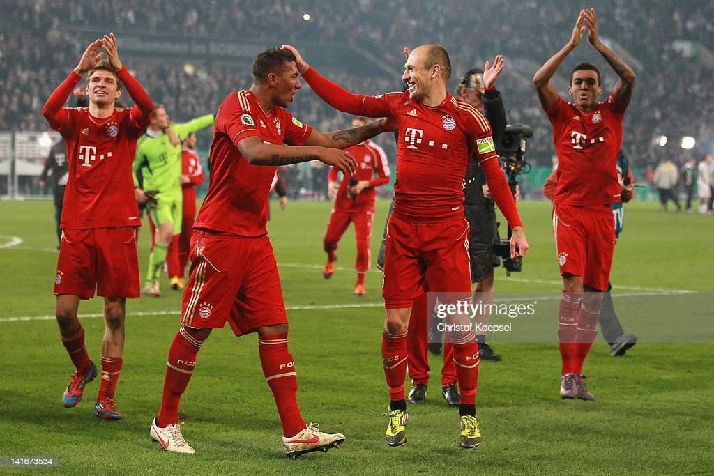 Jérome Boateng and Arjen Robben of Bayern celebrate the 4-2 victory after penalty shoot-out after the DFB Cup semi final match between Borussia Moenchengladbach and FC Bayern Muenchen at Borussia Park Stadium on March 21, 2012 in Moenchengladbach, Germany.