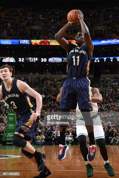 Jrue Holdiay of the New Orleans Pelicans takes a shot against the Boston Celtics on January 12 2015 at the TD Garden in Boston Massachusetts NOTE TO...