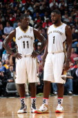 Jrue Holiday and Tyreke Evans of the New Orleans Pelicans talk during he game against the Los Angeles Lakers on November 8 2013 at the New Orleans...