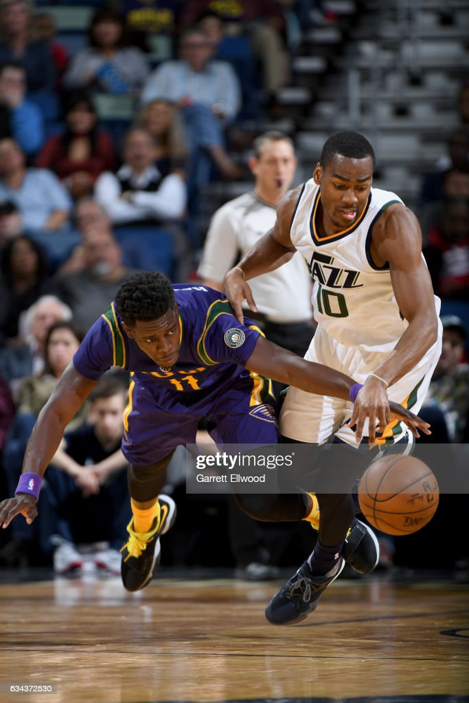 Jrue Holiday #11 of the New Orleans Pelicans and Alec Burks #10 of the Utah Jazz dive for a loose ball during the game on February 8, 2017 at the Smoothie King Center in New Orleans, Louisiana.