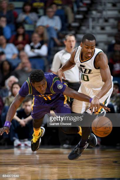 Jrue Holiday of the New Orleans Pelicans and Alec Burks of the Utah Jazz dive for a loose ball during the game on February 8 2017 at the Smoothie...