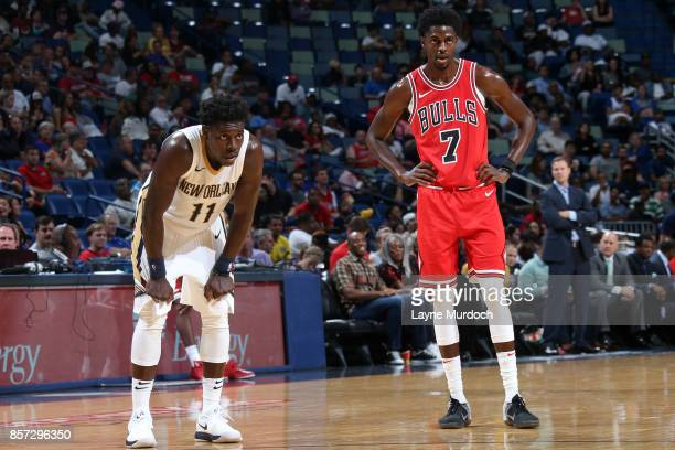 Jrue Holiday of the New Orleans Pelicans and Justin Holiday of the Chicago Bulls look on during a preseason game on October 3 2017 at the Smoothie...